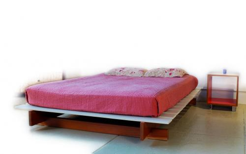 This fun bed has colorful slats supported by an open  balanced architecture  below  Just throw your mattress on  and turn the lava. Marcus Studio   Bauhaus Platform Bed   Furniture Store